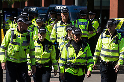 © Licensed to London News Pictures . 19/05/2018. Manchester, UK. Police on patrol in Manchester City Centre as the Football Lads Alliance demonstrate in Manchester , three days before the first anniversary of the Manchester Arena terror attack . Photo credit: Joel Goodman/LNP