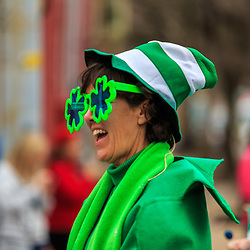 York, PA / USA / USA - March 12, 2016: A woman wears green annual Saint Patrick's Day Parade.