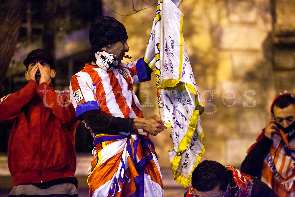 Supporters of Atletico Madrid celebrates at the Neptuno square in Madrid after Atletico de Madrid won the Spanish King's Cup  final football match against Real Madrid
