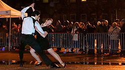 Dancers Eleanor and David Small perform in the rain for the Society Hill Dance Academy. (Bas Slabbers/for NewsWorks)<br /> <br /> http://www.newsworks.org/index.php/component/flexicontent/items/item/50760-manayunk-on-ice-