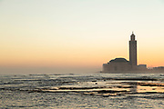 View of the sea and Hassan II Mosque from the beach in Casablanca, Morocco.