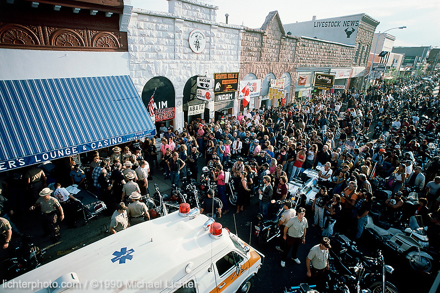 """Commotion at Gunners, Sturgis, SD, 1990<br /> <br /> Limited Edition Print from an edition of 50. Photo ©1990 Michael Lichter.<br /> <br /> The Story:""""In the old days you went on a run and it was a run.  You didn't know if some guy in a pick up truck would pull up alongside and blow you off the road like in the movie, run you off the road, if a truck driver could run over you, or you'd end up in jail because you were a biker and you were probably carrying drugs and maybe a gun.  And when you got there you wouldn't know if a club would beat you half to death or if you'd get arrested by the citizens because you beat up some people in a bar.  There were lots of things going on at that time that made it much more of an adventure.  It's still an adventure to ride to Sturgis.""""<br /> <br /> From an interview with Keith Ball, Bikernet.com, (then editor of Easyriders Magazine), June, 1991"""