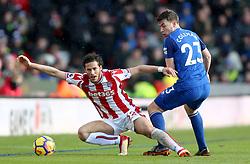 Stoke City's Ramadan Sobhi (left) and Everton's Seamus Coleman battle for the ball