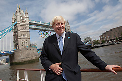 © licensed to London News Pictures. London, UK 27/06/2012. Mayor of London Boris Johnson posing after unveiling the giant Olympic rings which are displayed from Tower Bridge, today. Photo credit: Tolga Akmen/LNP