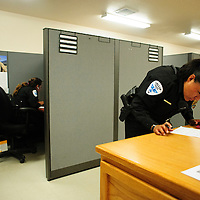 072413  Adron Gardner/Independent<br /> <br /> Gallup Police Officer rookie Tasheena Wilson puts finishing touches on a police report at the end of her shift in Gallup Wednesday.