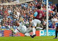 Photo: Henry Browne.<br /> Crystal Palace v West Ham United. Pre Season Friendly.<br /> 30/07/2005.<br /> Matthew Etherington of West Ham scores the first goal of the match past Palace keeper Gabor Kiraly.
