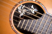 A beautiful hummingbird inlay is the focal point of an acoustic guitar handmade by North Carolinian Bobby Denton