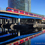 I wonder if everyone inside the train is dressed so colourfully? Beautiful sunlight at Canary Wharf on morning bike ride. Shot on iPhone 6.