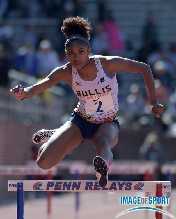 Apr 26, 2018; Philadelphia, PA, USA; Masai Russell of Bullis (Md.) wins the girls 400m hurdles in 58.49 during the 124th Penn Relays at Franklin Field.