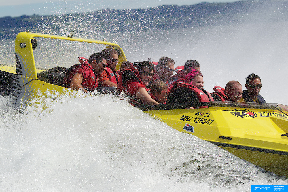 People enjoy the speed and spins and the adrenaline rush of the Kawarau Jet boat on Lake Rotorua.  The half hour thrill ride also includes passing historical landmarks of  Mokoia Island, the Sacred Island and the world renowned Sulphur Lake. Rotorua .New Zealand. 11th December 2010. Photo Tim Clayton