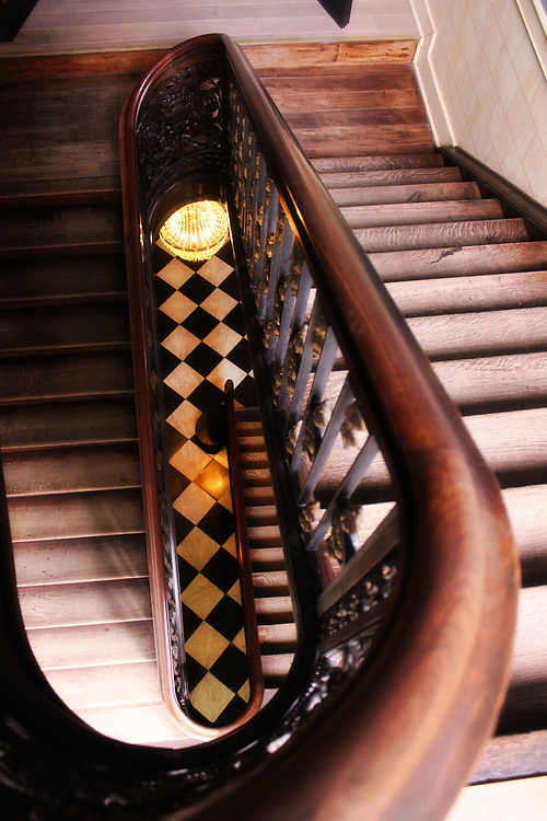 Old staircase in a hotel, Bruges, Belgium