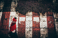A man walks by signs calling for the independence of Nagaland in Kohima, the capital of Nagaland state in northeastern India.