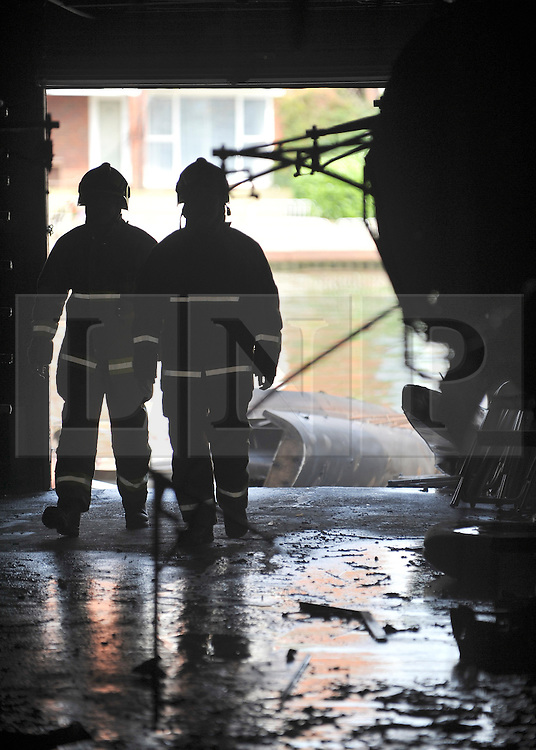 © licensed to London News Pictures. MARLOW, UK.  03/08/11. Firemen inspect the damage. Marlow Rowing Club has been badly damaged by fire today (03 August 2011). Boats with an estimated value of 100,000 pounds have been damaged. Steve Redgrave, Olympic Rower, who trained at the club and is from Marlow said his daughters boat is believed to be inside.  Mandatory Credit Stephen Simpson/LNP