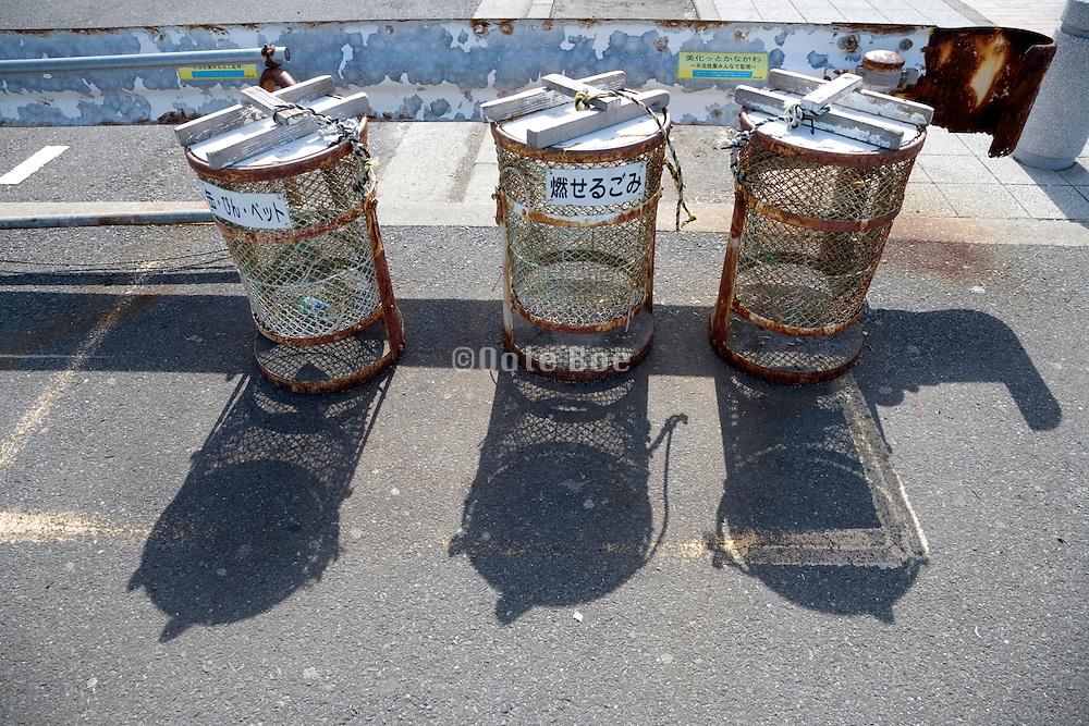 old rusty roadside recycle garbage bins Japan