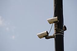 ANPR cameras monitoring traffic to identify unpaid vehicle tax