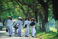 """Schoolgirls in traditional Ao Dai in the former imperial city of Hue, Vietnam<br /> Available as Fine Art Print in the following sizes:<br /> 08""""x12""""US$   100.00<br /> 10""""x15""""US$ 150.00<br /> 12""""x18""""US$ 200.00<br /> 16""""x24""""US$ 300.00<br /> 20""""x30""""US$ 500.00"""