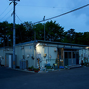 View of prefabricated houses used as temporary shelter for families who lost their homes during the devastating earthquake and tsunami that hit Togura, a fishing village in the east coast of Japan, in 2011. On the third anniversary of the disaster, nearly 270,000 remain displaced.