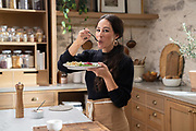 Joanna Gaines tastes her friendsgiving meal, as seen on Jo's Cooking Show, Season 1.