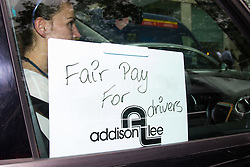 """Mayfair, London, May 24th 2016. Drivers from minicab operator Addison Lee bring traffic to a standstill in Berkely Square, outside of the offices of owner Carlyle Group, in protest against new """"unfair"""" pay rates as the company battles to compete with cut-price Uber, with some drivers claiming they are earning as little as £4.99 per hour."""