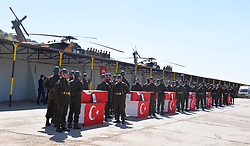 Turkish military personnel stand next to coffins bearing the remains of victims of an helicopter crash on June 1, 2017, in the southeastern city of Sirnak. Thirteen Turkish soldiers were killed on May 31, 2017 when a military helicopter crashed after hitting a high-voltage power line in the southeast of the country, the army said. The AS532 Cougar helicopter crashed shortly after taking off from a base in Sirnak province bordering Iraq, killing all 13 onboard, it said in a statement. Sirnak, Turkey, on June 01, 2017. Photo by Sekvan Kuden/Dha/Depo Photos/ABACAPRESS.COM