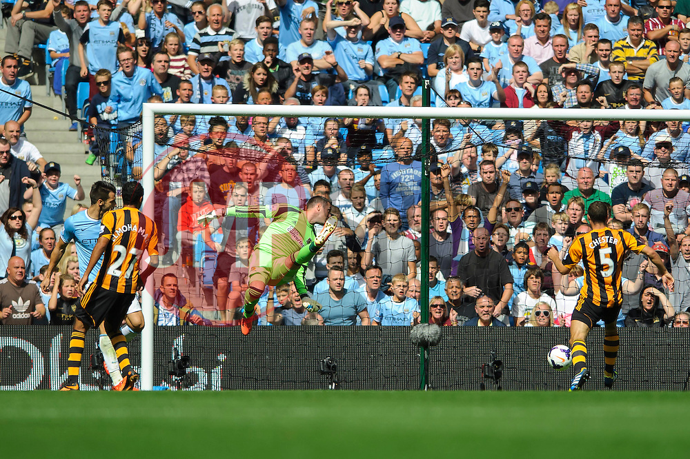 Man City Forward Alvaro Negredo beats Hull Goalkeeper Allan McGregor (SCO) and scores the opening goal of for his side during the second half of the match - Photo mandatory by-line: Rogan Thomson/JMP - Tel: Mobile: 07966 386802 31/08/2013 - SPORT - FOOTBALL - Etihad Stadium, Manchester - Manchester City v Hull City Tigers - Barclays Premier League.