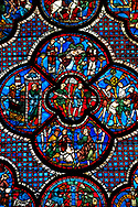 Medieval stained glass Window of the Gothic Cathedral of Chartres, France - dedicated to the lGood Samaritan . Central panel shows A bandit prepares to attack the pilgrim , below  - Christ telling the parable to a couple of Pharisees, left -The pilgrim leaving Jerusalem, right -  The pilgrim is beaten, robbed and stripped , above - A Priest and a Levite see the injured man but walk on past. A UNESCO World Heritage Site. .<br /> <br /> Visit our MEDIEVAL ART PHOTO COLLECTIONS for more   photos  to download or buy as prints https://funkystock.photoshelter.com/gallery-collection/Medieval-Middle-Ages-Art-Artefacts-Antiquities-Pictures-Images-of/C0000YpKXiAHnG2k
