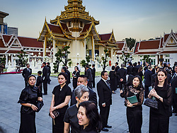November 3, 2018 - Bangkok, Bangkok, Thailand - Mourners on the first day of funeral rites for Vichai Srivaddhanaprabha gather in front of the crematorium after bathing rites at Wat Debsirin in Bangkok. Vichai was the owner of King Power, a Thai duty free conglomerate, and the Leicester City Club, a British Premier League football (soccer) team. He died in a helicopter crash in the parking lot of the King Power stadium in Leicester after a match on October 27. Vichai was Thailand's 5th richest man. The funeral is expected to last one week. (Credit Image: © Sean Edison/ZUMA Wire)