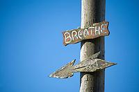 Breathe sign on telephone pole.