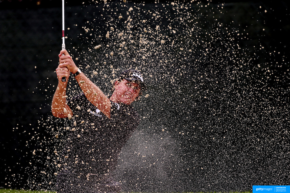 Phil Mickelson chips out of the sand trap on the 13th hole during the second round of theThe Barclays Golf Tournament at The Ridgewood Country Club, Paramus, New Jersey, USA. 22nd August 2014. Photo Tim Clayton