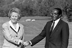 File photo dated 01/10/88 of Margaret Thatcher with Robert Mugabe, whose legacy as one of the most ruthless tyrants of modern times will remain long after his days as notorious statesman of Zimbabwe are over.