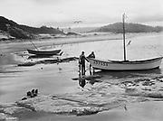 9969-7290. Fishermen unloading fish from their boat at the beach landing at Cape Kiwanda. July 22, 1948.
