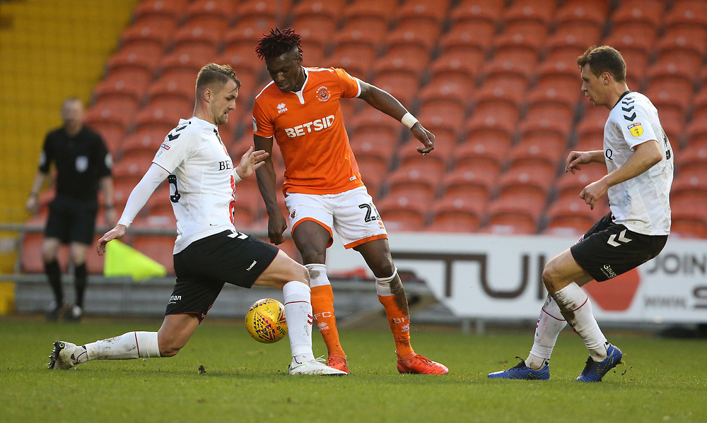 Blackpool's Armand Gnanduillet is tackled by Charlton Athletic's Patrick Bauer<br /> <br /> Photographer Stephen White/CameraSport<br /> <br /> The EFL Sky Bet League One - Blackpool v Charlton Athletic - Saturday 8th December 2018 - Bloomfield Road - Blackpool<br /> <br /> World Copyright © 2018 CameraSport. All rights reserved. 43 Linden Ave. Countesthorpe. Leicester. England. LE8 5PG - Tel: +44 (0) 116 277 4147 - admin@camerasport.com - www.camerasport.com