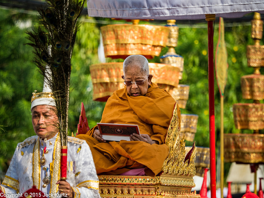 16 DECEMBER 2015 - BANGKOK, THAILAND:  A senior Buddhist monk meditates during the funeral procession for Somdet Phra Nyanasamvara, who headed Thailand's order of Buddhist monks for more than two decades and was known as the Supreme Patriarch. He was ordained as a Buddhist monk in 1933 and appointed as the Supreme Patriarch in 1989. He was the spiritual advisor to Bhumibol Adulyadej, the King of Thailand when the King served as a monk in 1956. Tens of thousands of people lined the streets during the procession to pray for the Patriarch.    PHOTO BY JACK KURTZ