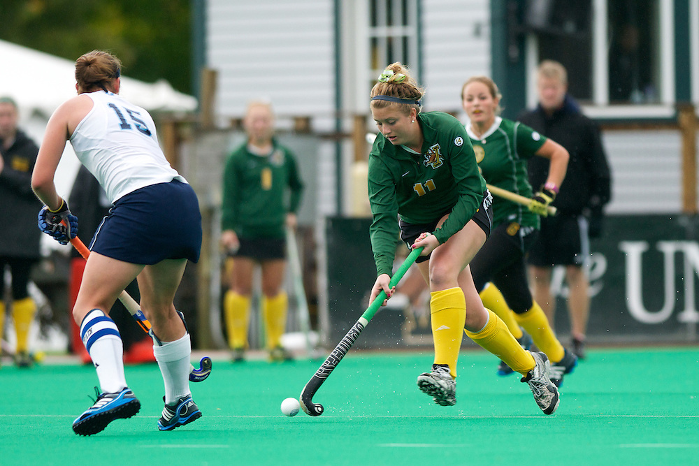 Catamounts midfielder Callie Bellimer (11) in aciton during the women's field hockey game between the Maine Black Bears and the Vermont Catamounts at Moulton/Winder Field on Saturday afternoon September 29, 2012 in Burlington, Vermont.
