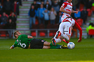 Liam Kelly of Coventry City (6) tackles Kieran Sadlier of Doncaster Rovers (22) during the EFL Sky Bet League 1 match between Doncaster Rovers and Coventry City at the Keepmoat Stadium, Doncaster, England on 4 May 2019.