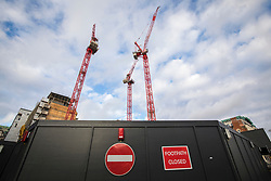© Licensed to London News Pictures. 15/01/2018. London, UK. Carillion cranes on a closed construction site in central London. The construction firm has gone into liquidation after losing money on big contracts and running up debts of around £1.5bn. Photo credit: Rob Pinney/LNP