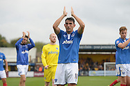 Gary Roberts of Portsmouth celebrates with the Portsmouth fans after the final whistle. Skybet football league two match, Cambridge Utd v Portsmouth at the Abbey Stadium  in Cambridge on Saturday 10th October 2015.<br /> pic by John Patrick Fletcher, Andrew Orchard sports photography.