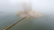 EZHOU, CHINA - JULY 14: <br /> <br /> Explosives destroy the dike between Liangzi Lake and Niushan Lake on July 14, 2016 in Ezhou, Hubei Province of China. Armed police used 30 tonnes of explosives blew up the 3.7-kilometer-long dike between Liangzi Lake and Niushan Lake to make the distributary of the possible flood on Thursday in Ezhou, Hubei Province.<br /> ©Exclusivepix media