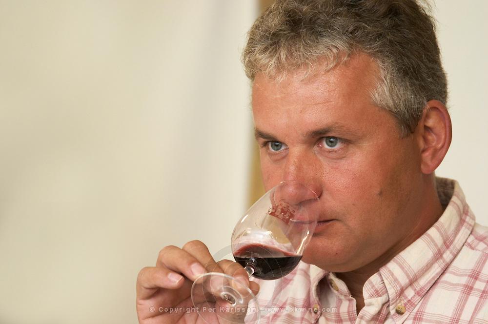 Joel Durand tasting a glass of wine.  Domaine Eric et Joel Joël Durand, Ardeche, Ardèche, France, Europe