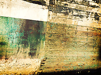 Abstract images of boat hulls and water reflections, wire and metal.
