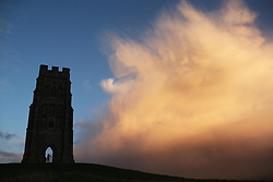 © Licensed to London News Pictures. 06/01/2014. Glastonbury, UK Thunder clouds form over Glastonbury Tor today 6th January. Photo credit : Jason Bryant/LNP