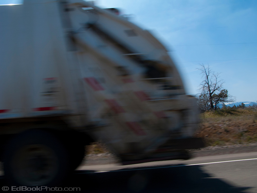 scene along a cross country trip with in a classic Mini Cooper auto - garbage truck blocks view of Mt Jefferson