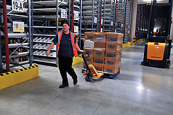 © London News Pictures. 2011/01/14 . A worker brings in books previously stored in a salt mine in Cheshire to the new facility. The Bodleian Book Storage Facility (BSF) in Swindon, UK,  'ingests' its one millionth item, the book 'Journal of General Physiology Volume 1 1918-1919' on Friday, 14 January 2011. It has been achieved in just under three months and has required an average daily ingest rate of 19,000 books and periodicals per day by 32 staff. On peak days, and depending on the materials, as many as 42,000 items have been ingested. . Picture credit should read Stephen Simpson/LNP