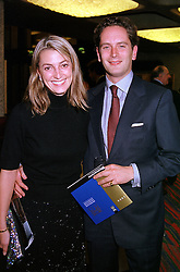 Publisher MISS BEATRICE VINCENZINI and her fiancee MR HUGO WARRENDER, at a reception in London on 23rd October 2000.OIC 56