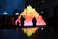 © Licensed to London News Pictures. 18/01/2020. LONDON, UK. Visitors interact with Mountain of Light by Angus Muir Design at the sixth Winter Lights festival in Canary Wharf.  25 light art and interactive installations by international artists are on display for the public to enjoy until 25 January 2020.  Photo credit: Stephen Chung/LNP