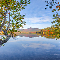 New England fall colors photography reflection at Lake Chocorua in the New Hampshire White Mountains National Forest. <br /> <br /> Lake Chocorua New Hampshire White Mountains National Forest fine art photography images are available as museum quality photo, canvas, acrylic, wood or metal prints. Wall art prints may be framed and matted to the individual liking and New England interior design projects decoration needs.<br /> <br /> Good light and happy photo making!<br /> <br /> My best,<br /> <br /> Juergen