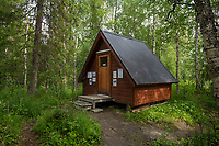 Small shelter in forest at southern trailhead of Padjelantaleden trail, Lapland, Sweden