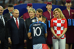 Croatia's President Kolinda Grabar-Kitarovic with France's President Emmanuel Macron presents France's forward Kylian Mbappe with the 2018 FIFA Best Young Player award at a victory ceremony after the 2018 FIFA World Cup final football match between France and Croatia at Luzhniki Stadium. on july 15, 2018. Photo by Lionel Hahn/ABACAPRESS.COM