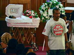07 September 2013. New Hope Baptist Church. New Orleans, Louisiana. <br /> Mourners attend the funeral service for 1 year old toddler Londyn Unique Reed Samuels, shot to death August 29th.  The infant Londyn was shot by thugs whilst in the arms of her babysitter, the intended victim who was holding Londyn whilst walking down the street at the time of the assault. NOPD has arrested 2 men in connection with the heinous crime.<br /> Photo; Charlie Varley