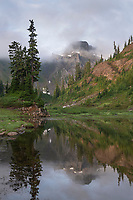 Table Mountain reflected in Lower Bagley Lake. Heather Meadows Recreation Area, Mount Baker Snoqulane National Forest. North Cascades Washington